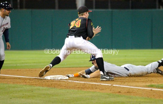 Michael Lorenzen dives into third base with a two-run triple.
