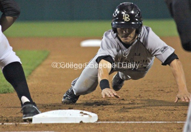 Colby Brenner dives into first base.