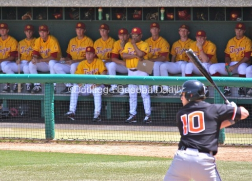 Frank Cruz and the USC dugout look on at Dylan Davis batting.