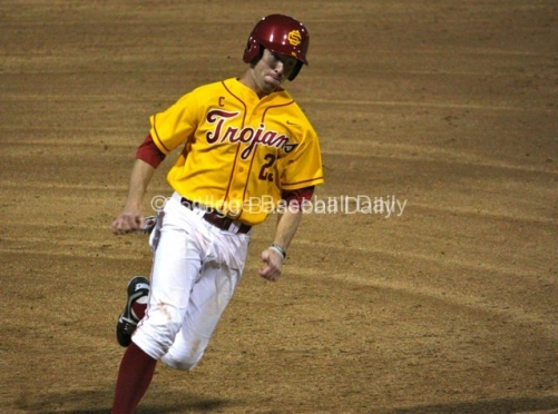 Garret Houts rounds third base.