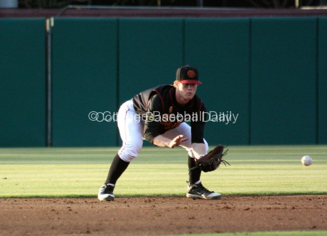Adam Landecker takes a grounder.
