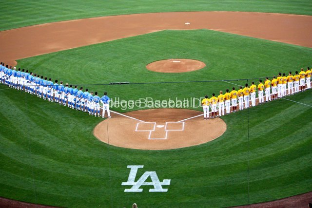 USC and UCLA line the field during the national anthem.
