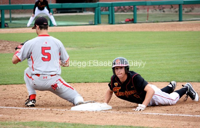 Garrett Stubbs dives back into first.