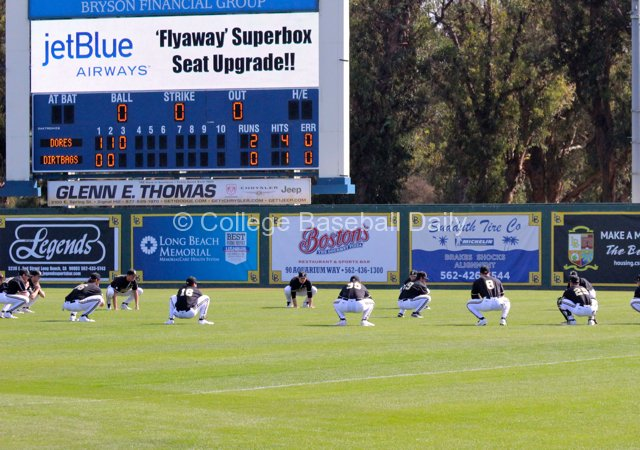 Vanderbilt performs synchronized team stretches between innings.