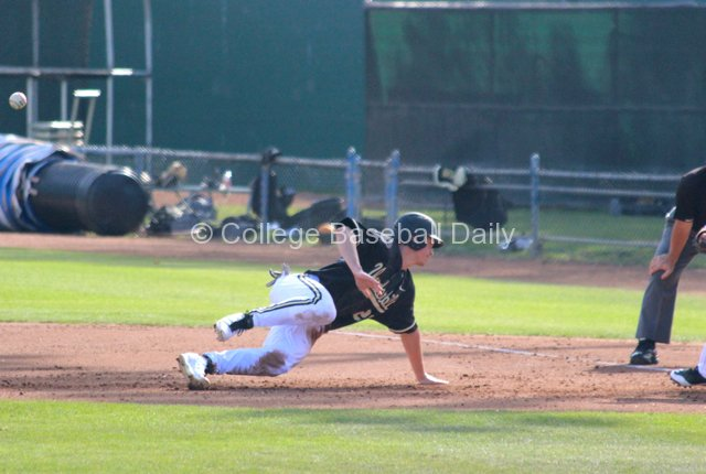 Bryan Reynolds slips on a pickoff.