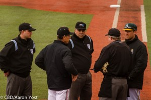 Wright State coach Greg Lovelady, in his first season in charge of the Raiders, listens to the plate talk with 20th-year Oregon State coach Pat Casey and plate umpire Mike Whitty.