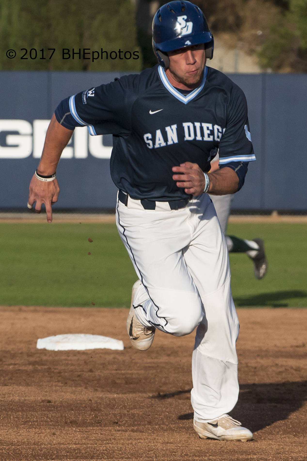 lbsu Josh Advocate celebrates his strikeout to force a winner
