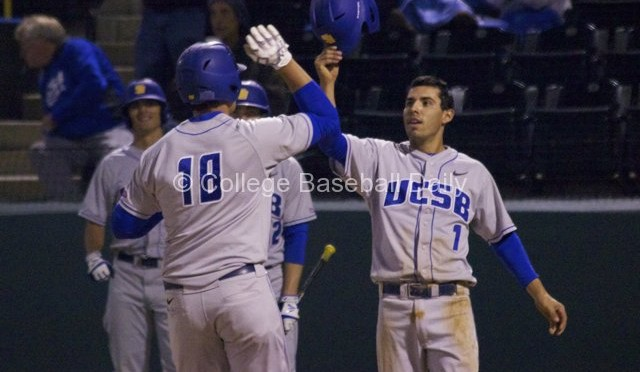 Tyler-Kuresa-is-greeted-after-his-homer-by-Peter-Maris